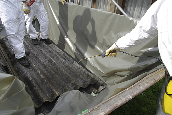 Asbestos removal team working on removing dangerous materials