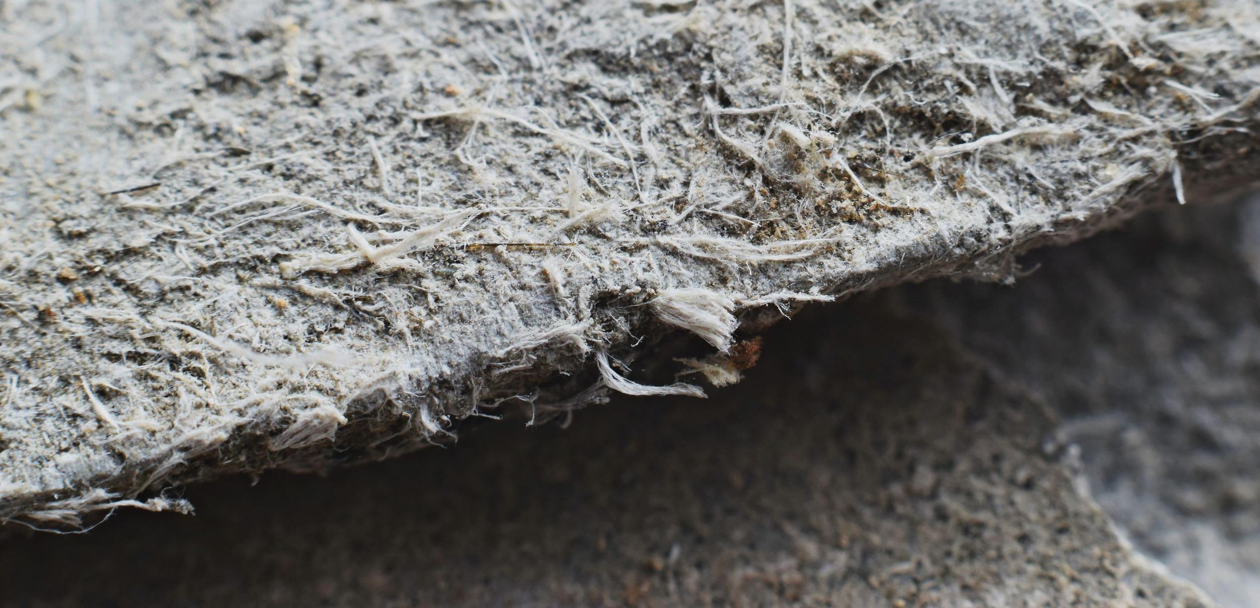 Asbestos fiber roofing material