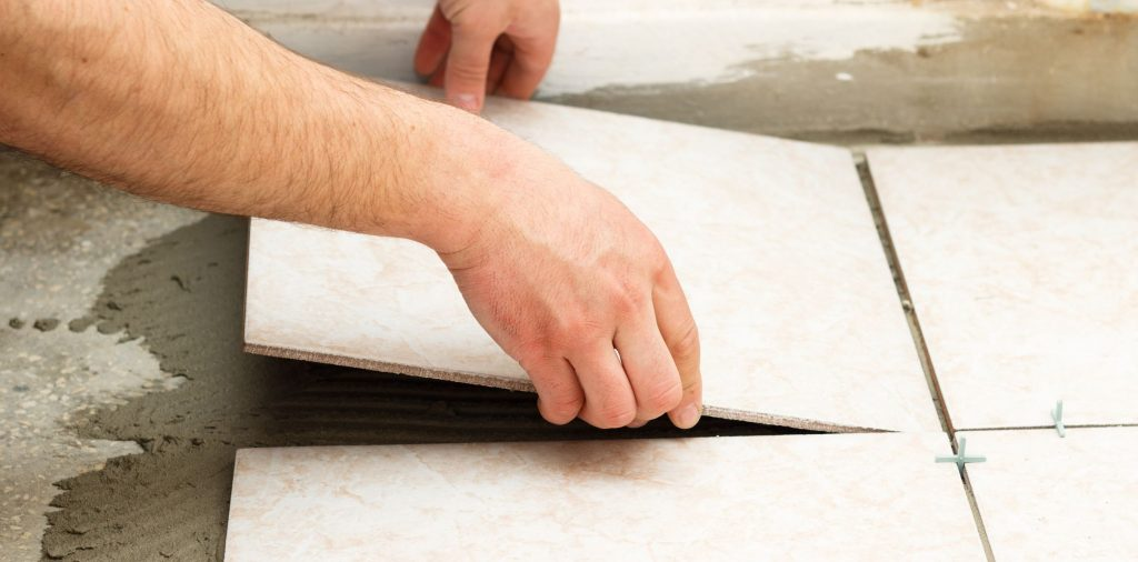 Contractor installing tile