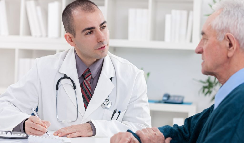 Doctor speaking with patient and taking notes