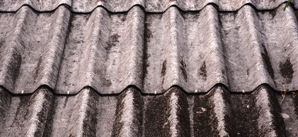 Damaged asbestos roof shingles