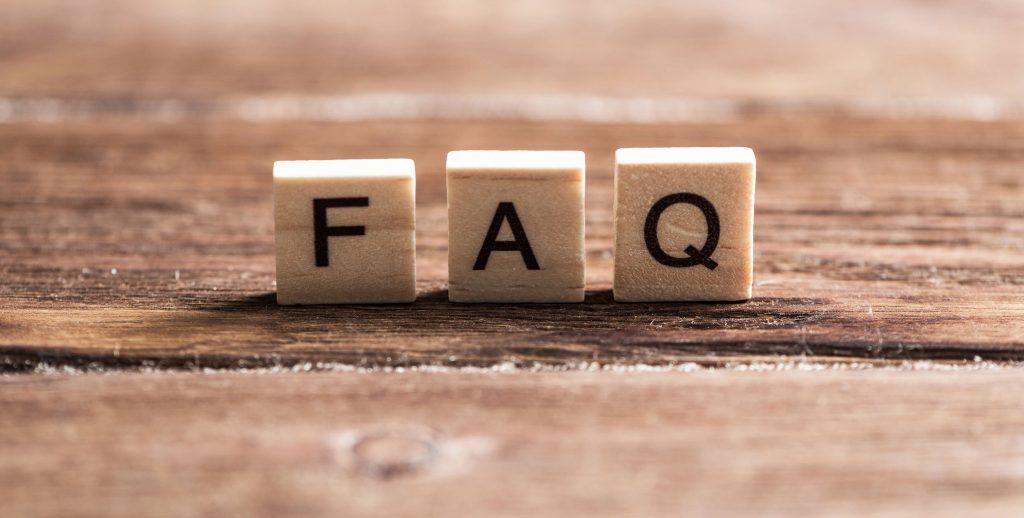 Letters on wooden blocks spelling FAQ