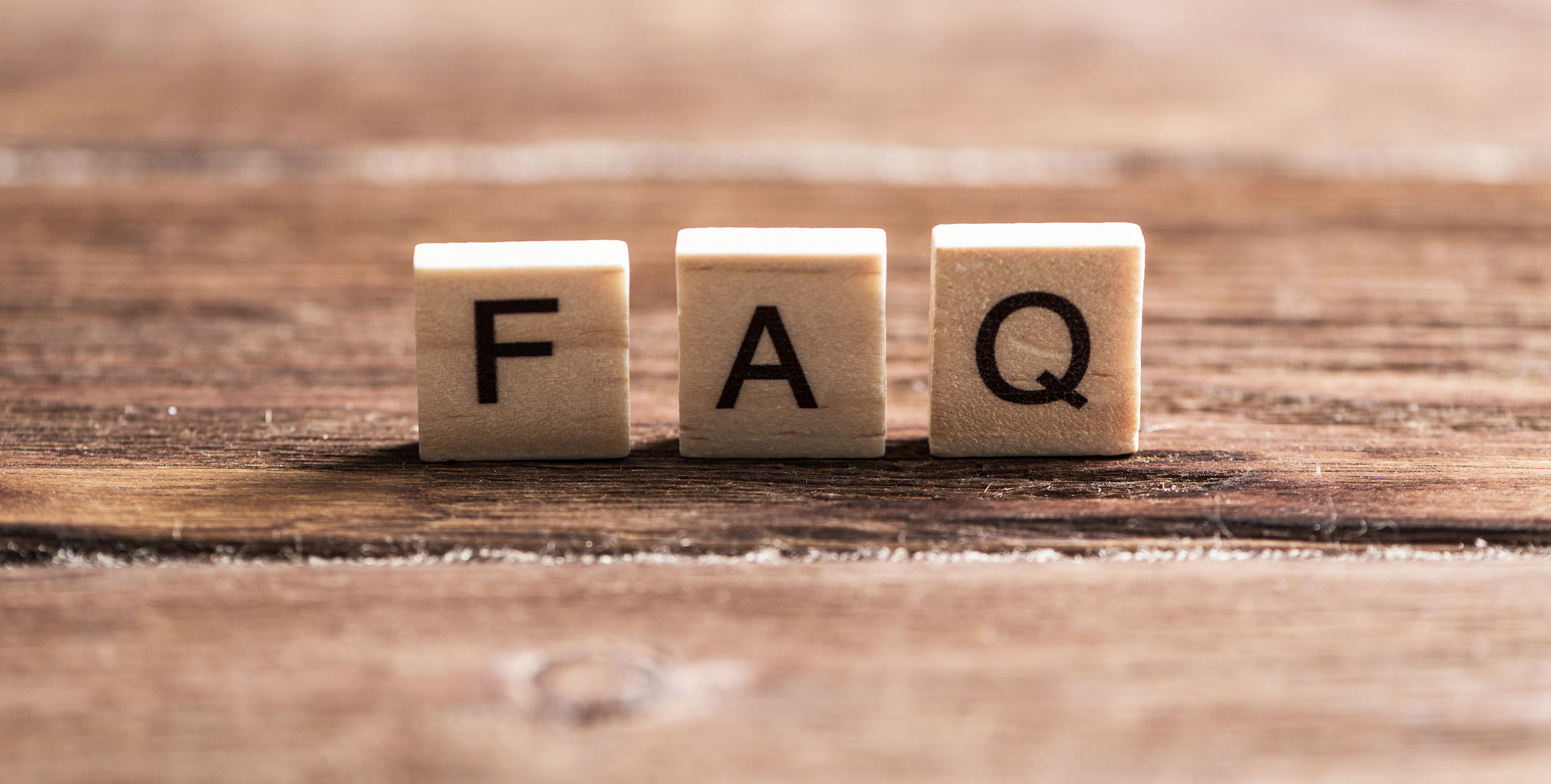 Letters on wooden blocks spelling FAQ