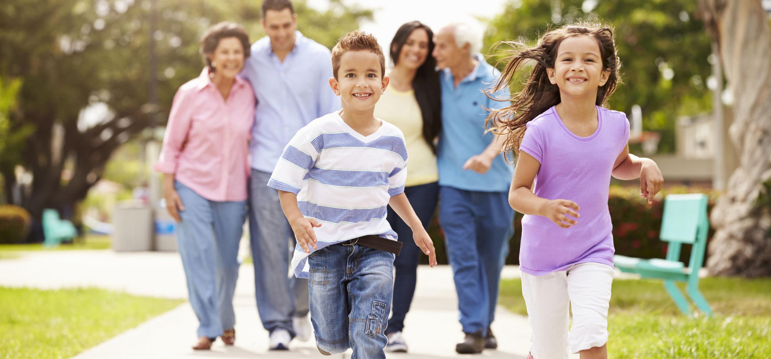 Multi generational family walking in park