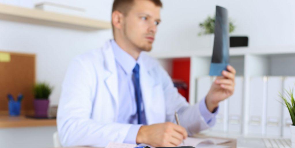 Doctor examining an xray