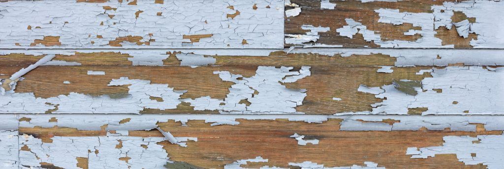 Cracking and peeling lead paint off of wood sliding