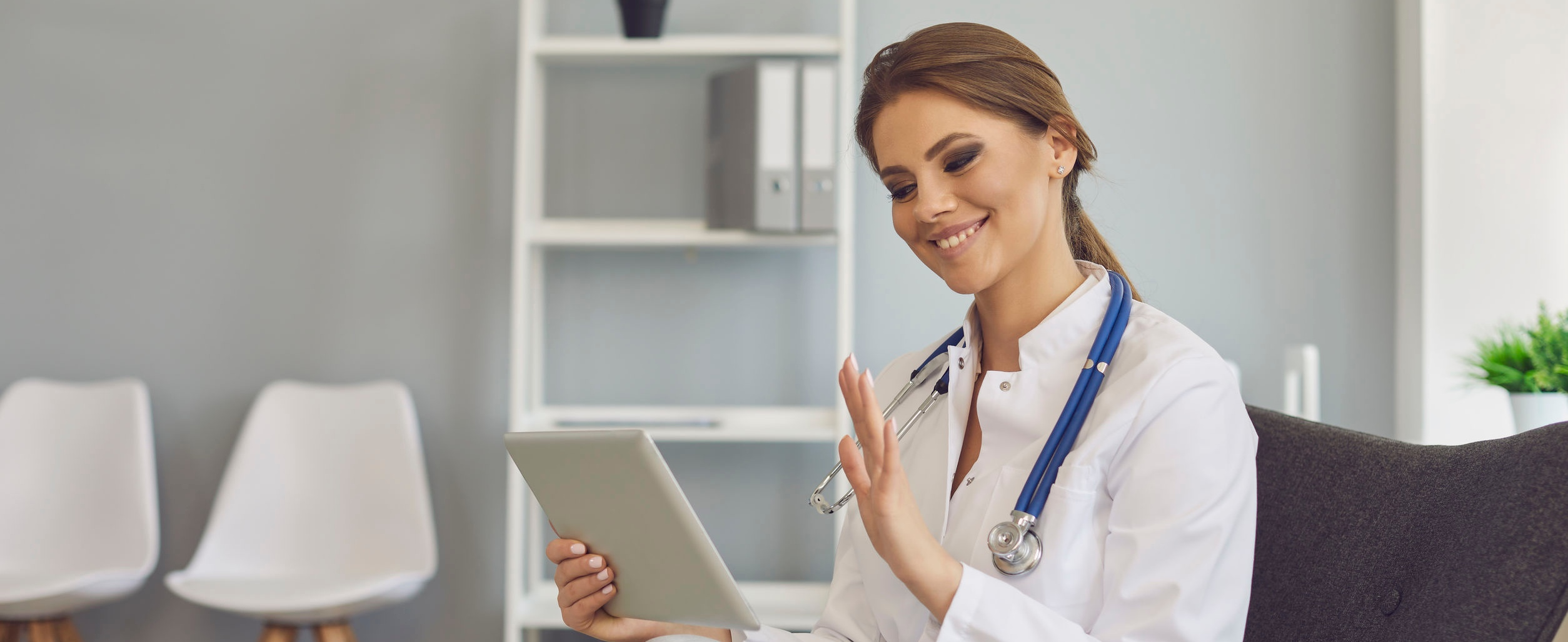 Doctor consulting with patient through tablet