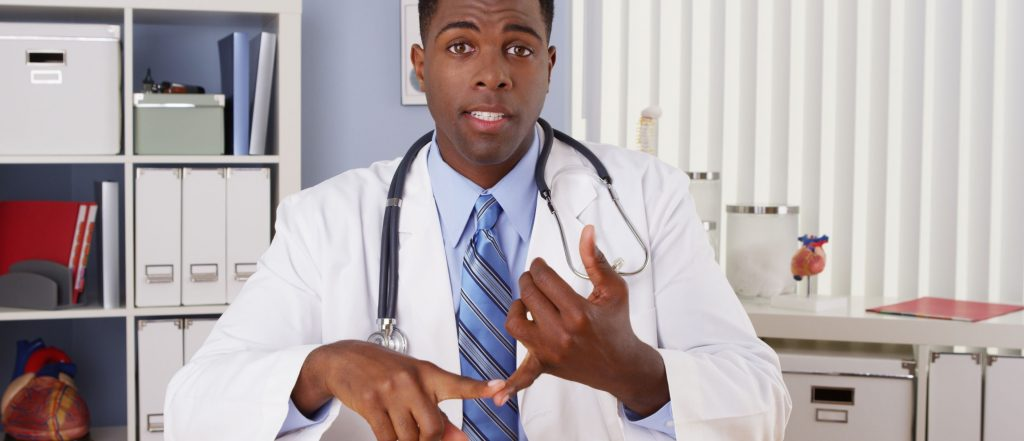 Doctor talking to camera in video chat