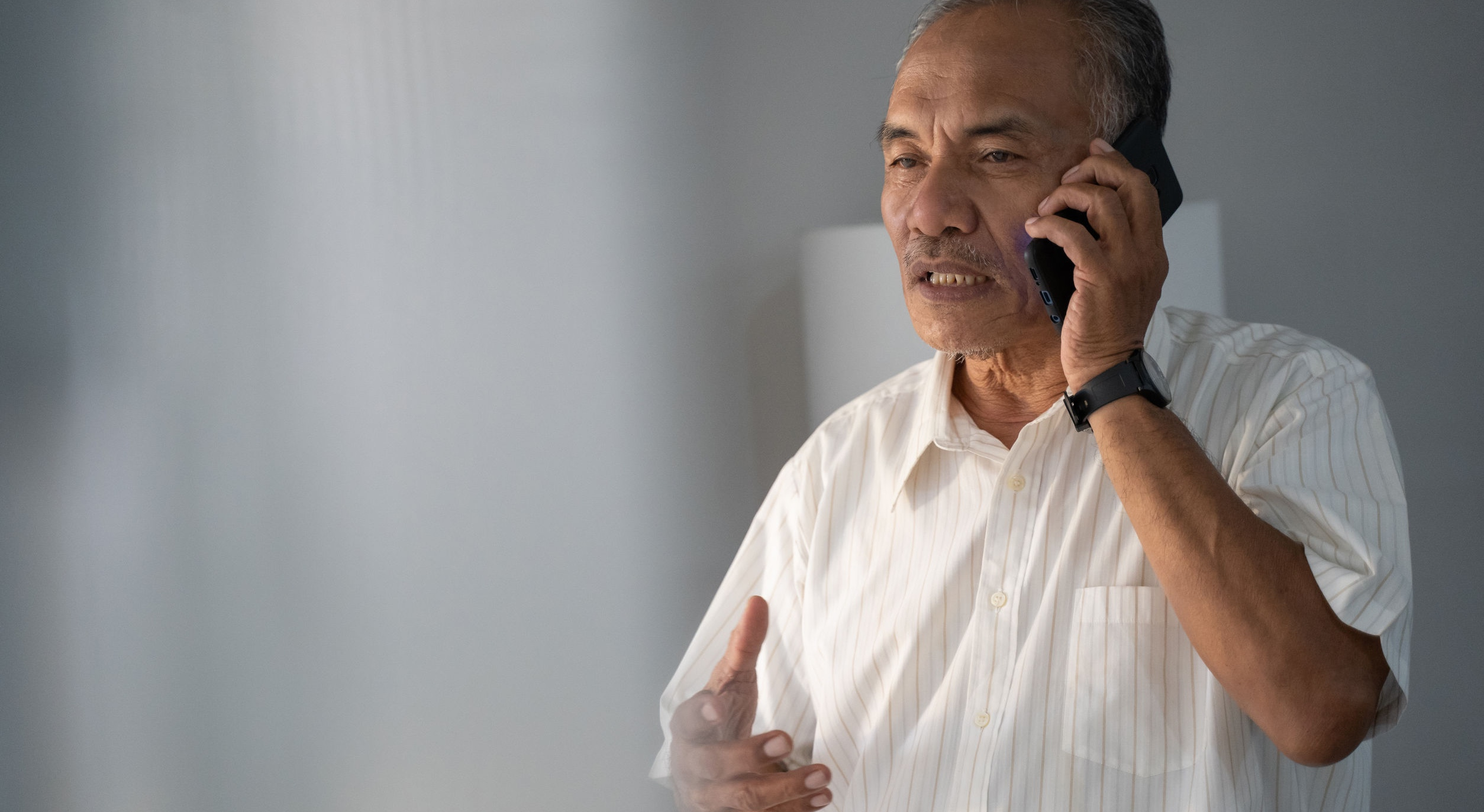 Man making a call on a cell phone