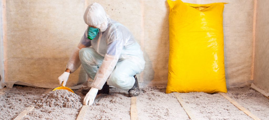 Man working with insulation in a home