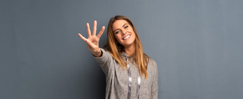 Woman holding out four fingers