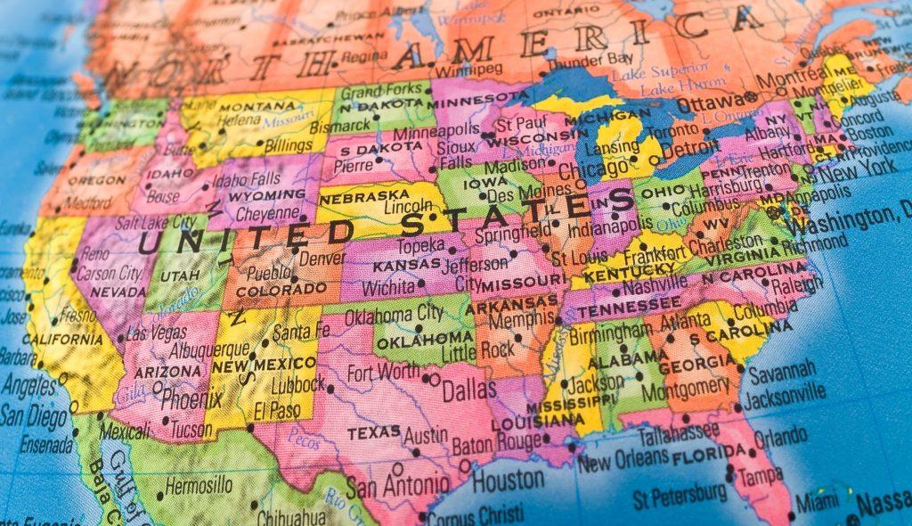 A macro closeup of a political globe focusing on the United States