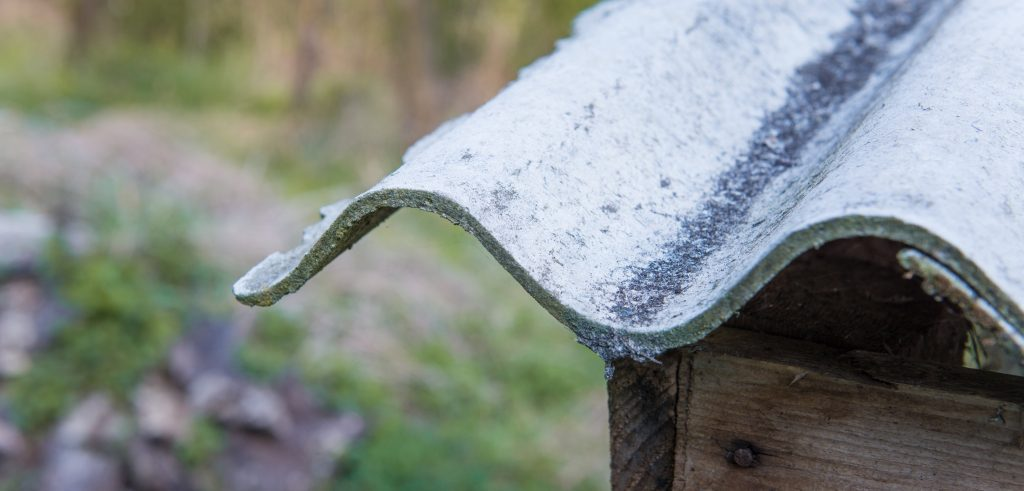 Asbestos roof shingle on a residential structure